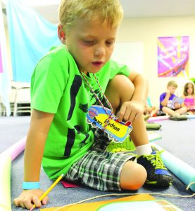 Graphics courtesy of LifeWay Amanda Crane/Press-Tribune Hudson Brignac participates in Cypress Baptist's first grade Vacation Bible School with an activity in work books last week. Cypress is one of the many churches offering outreach to the community through the seasonal events.
