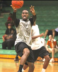 Russell Hedges/Press-Tribune Bossier's Devonte Hall, the co-MVP on the All-Parish team last season, makes a pass during a summer league game at Bossier Thursday.