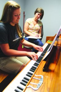 Brittany Bolton, 15, took her first private piano lesson at the new Haughton School of Music Thursday afternoon with owner Shana Houston. Bolton, a sophomore at Airline High School, has been a student with Houston for three years.