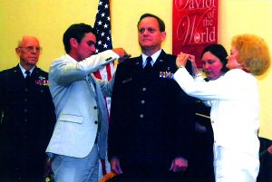 Air Force chaplain Scott Adams, a Bossier City native, was promoted to the rank of Colonel Sunday in West Monroe. He received his pins from his mother, Dorothy Adams, son, Ross, and was given the oath of appointment by Col. Bruce Seeber (USAF, ret.)