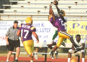 Benton's CJ McQuarters defends a pass during the Tigers' scrimmage against Green Oaks Friday night at Benton.