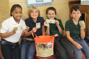 Waller Elementary School has been raising money to send on an international mission trip to Nepal this fall. Students, teachers and administrators have emptied their pockets all week for the cause. Pictured are fifth graders Tanara McCain, Kaylin Honey, Logan Smith and Jeremiah Higgins.