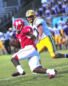 Jere Grice/Press-Tribune Haughton quarterback Will Haines passed for three touchdowns and ran for one in the Bucs' 52-14 victory over Benton Friday night.
