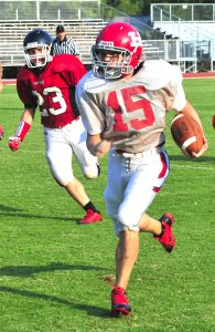 Jere Grice/Press-Tribune Haughton's Jonathan Plant threw two touchdown passes in the Bucs' 21-14 victory over Parkway in a freshman season opener Tuesday at Haughton.