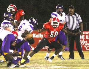 Randy Brown/Press-Tribune Louisiana New Tech at Plain Dealing's Herbert McCauley (50) eyes a Logansport ballcarrier during the Lions' 48-41 victory Friday night.