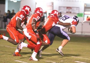 Randy Brown/Press-Tribune Haughton defenders try to bring down Airline quarterback Jacob James.