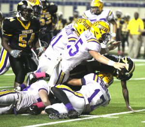 Randy Brown/Press-Tribune Benton defenders bring down a Fair Park player during the Tigers' loss Friday night at Independence Stadium.