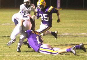 Jeff Thomas/Press-Tribune Benton's Austin Simmons (17) brings down a Loyola player during the Tigers' 35-7 victory.