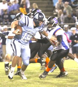 Airline quarterback Jacob James tries to avoid a Southwood defender Friday night.