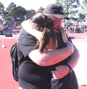 Russell Hedges/Press-Tribune Parkway coach Kent Falting and runner Alison Ringle hug during the aftermath of Parkway's Class 5A state cross championship last week.