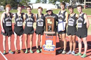 Russell Hedges/Press-Tribune The Benton Tigers pose with their trophy after winning the Class 4A cross country state championship for the second year in a row Monday at Northwestern State University.