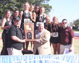 Russell Hedges/Press-Tribune The Parkway Lady Panthers pose on the victory stand with their trophy after winning the Class 5A cross country state championship Monday at Northwestern State University in Natchitoches.
