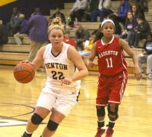 Randy Brown/Press-Tribune Benton's Madi Sessions drive around Haughton's Mikayla Barber during the Lady Tigers' victory Tuesday night at Benton. The Lady Tigers visit Captain Shreve tonight, and the Lady Bucs host Minden.