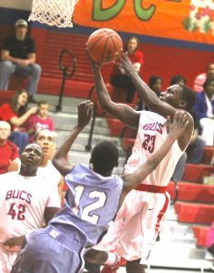 Haughton's Javonte Woodard takes the ball to the basket against Airline Friday night.