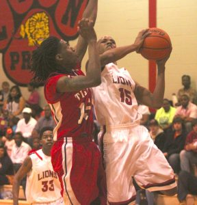 Russell Hedges/Press-Tribune Louisiana New Tech at Plain Dealing's Isaac Jacobs takes the ball to the basket during the Lions' 58-41 victory over East Iberville in the first round of the Class 1A playoffs Friday night in Plain Dealing.