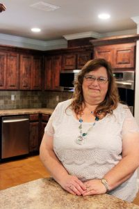 Robin Alderman stands in the kitchen built by the community through donations of money and services over the last year.