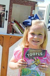 Three-year-old Hattie Brook Carr was very excited about her first book from the new Little Free Library in her neighborhood.
