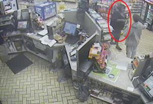 A second person (circled) is wanted in connection with the thefts.