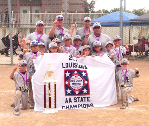 Courtesy Photo The Bossier All-Stars gather behind the championship banner after winning the Dixie 7-8 Machine Pitch state title in Lafayette.