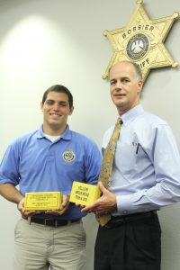 "Amanda Crane/Press-Tribune | Anthony Visciotti, 17, and Bossier Sheriff Julian Whittington are graduates of the FBI National Academy Youth Leadership Program. They met recently to compare experiences and also show off the yellow bricks they both earned for completing the ""Yellow Brick Road,"" a physically demanding fitness challenge."