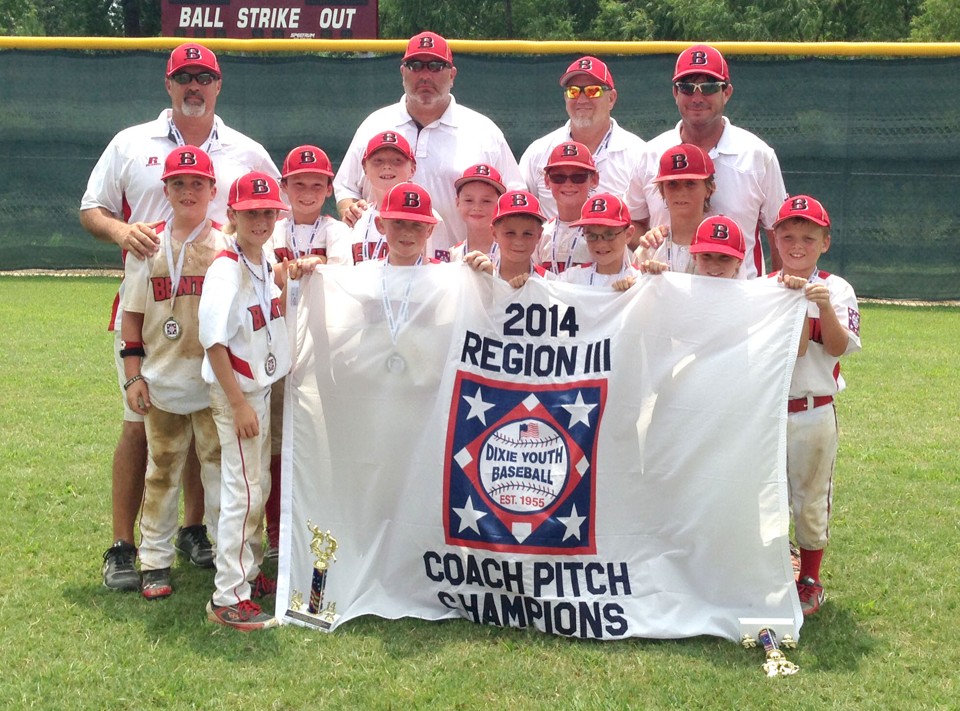 Courtesy Photo/ The Benton Nationals All-Stars pose for a team photo after winning the Dixie 7-8 Coach Pitch Region III World Series title Monday in Longview, Texas.