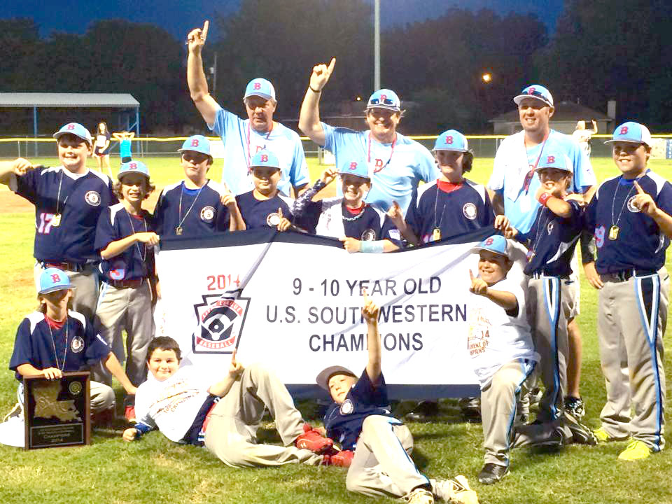 Courtesy Photo The Bossier Nationals gather with the championship banner after winning the Little League Baseball Southwest Region 9-10 Tournament of Champions last week.
