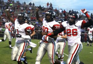 Randy Brown/Press-Tribune Parkway's CJ Morgan, Lloyd Cole and Kaleb Monroe celebrate Monroe's interception return for a TD against Haughton Friday night in the Bossier Lions Club Jamboree.