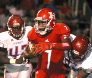 Randy Brown/Press-Tribune Haughton QB William Haines runs for yardage during the Bucs' victory over Minden Friday night in Haughton.