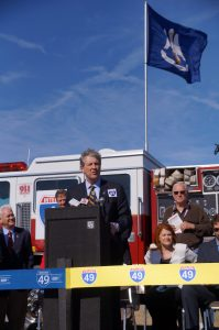 (Courtesy of Tom Pace) State Treasurer John Kennedy speaks at ribbon cutting of I-49 North that joins Louisiana and Arkansas.
