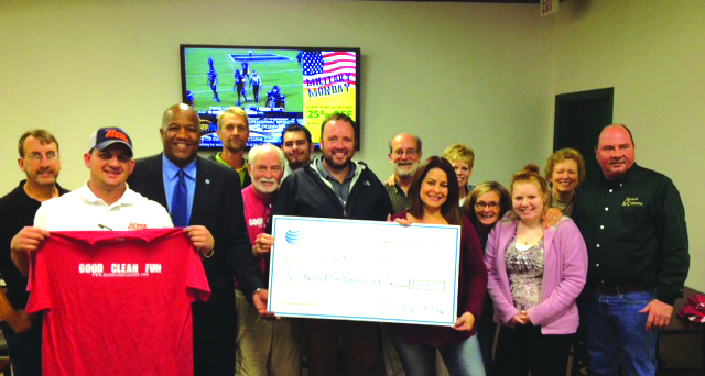 AT&Tregional director David Aubrey (third from left) presented a $2,500 check to the Red River Cleanup last month to allow the group to apply as an official non-profit.