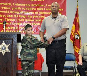 Commander Lavaro Ramey, presents the Honor Graduate Award to Ty Castro.