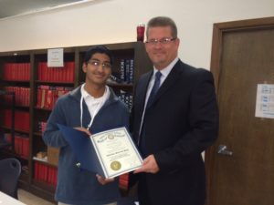 Courtesy Photo | Airline Principal Jason Rowland presents an official statement from  Louisiana Governor Bobby Jindal issued an Official Statement to senior Abhishek Shah, recognizing his accomplishment as a National Merit Scholar Finalist.