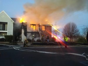 Courtesy of the Bossier Sheriff's Office | A fire at the Reserve Apartments, Benton, La., January 2014. Bossier Deputy Darryl Ware received the National Veterans of Foreign Wars Law Enforcement Award Thursday for saving a man who was trapped in an apartment on the upper floor.