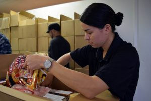 BOSSIER CITY, La. (April 25, 2015) Lt. Cmdr. Maura Thompson, supply officer of USS Louisiana (SSBN 743) at the Food Bank of Northwest Louisiana, the first community relations project of Navy Week Shreveport. Sailors from Navy Recruiting District Houston and USS Louisiana (SSBN 743) helped pack nearly 100 boxes that will be serviced out to any number of the 1300 citizens currently fed by the program. Each box weighed 45 lbs. and contained roughly 40 different dried food products. Navy Weeks focus a variety of assets, equipment and personnel on a single city for a week-long series of engagements designed to bring America's Navy closer to the people it protects, in cities that don't have a large naval presence. (U.S. Navy photo by Mass Communication Specialist 1st Class Chris Fahey/Released)