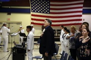 BOSSIER CITY, La. (April 27, 2015) Sailors and guests from the local community stand for the national anthem during an open house and ceremony at Bossier City Navy Operational Support Center (NOSC) to honor the Shreveport/Bossier city, parish, government and school officials, strengthen their continued partnerships and commemorate the 100th anniversary of the U.S. Navy Reserves. The ceremony, part of Navy Week Shreveport, featured Navy Divers, Explosive Ordnance Disposal technicians, the Navy Band, Rear Admiral Keith M. Jones and Sailors from both the local NOSC and Navy Recruiting District Houston. Navy Weeks focus a variety of assets, equipment and personnel on a single city for a week-long series of engagements designed to bring America's Navy closer to the people it protects, in cities that don't have a large naval presence. (U.S. Navy photo by Mass Communication Specialist 1st Class Chris Fahey/Released)