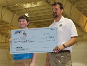 Top Male Shooter -- Aidan Haire receives a $2,000.00 scholarship from Louisiana Archery and Sports Center of Pineville; pictured are Aiden Haire, Benton Middle School, and Robert Stroede, ALAS State Coordinator.