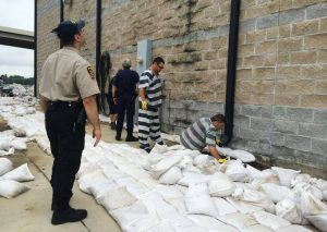 Courtesy of the Bossier Sheriff's Office | Inmate crews place sandbags around the substation on Arthur Ray Teague Parkway ahead of the projected crest of 34 feet on June 6.