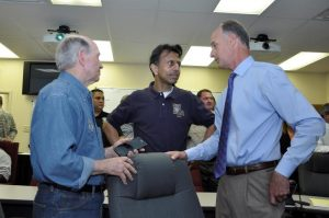 Photo by Lt. Bill Davis, Bossier Sheriff's Office | Bossier City Mayor Lo Walker, Gov. Bobby Jindal and Bossier Sheriff Julian Whittington discuss the flooding situation in Bossier Parish.