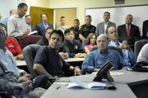 Photo by Lt. Bill Davis, Bossier Sheriff's Office | Gov. Bobby Jindal, Bossier Mayor Lo Walker and Bossier Sheriff Julian Whittington listen to area officials talk about the rising Red River.