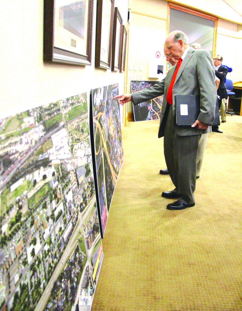 Mayor Lo Walker and city officials inspect the renderings for the plan to redevelop Old Bossier into a live/work/play atmosphere.