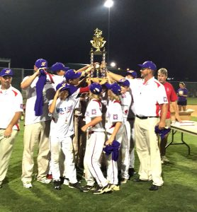 Courtesy Photo The Haughton All-Stars hoist the championship trophy after winning the Dixie Youth O-Zone (12s) state tournament in Concordia Parish on Tuesday night.