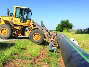 Contractors work on a section of sewer line south of I-220 just east of Shed Road.