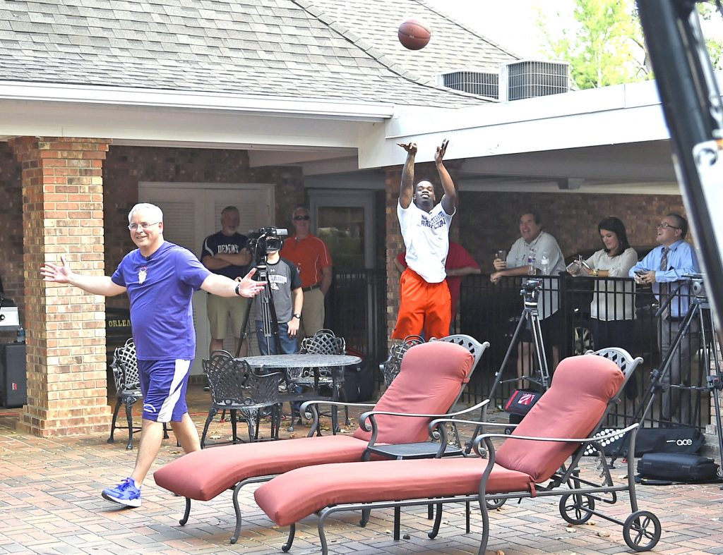 Gary Hardamon/Special to The Press-Tribune NSU senior point guard Jalan West, a former Bossier High star, launches a shot during a game of H-O-R-S-E against NSU President Dr. Jim Henderson Monday  at Dr. Henderson's home.