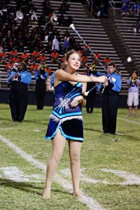 Amanda Simmons/Press-Tribune | Keriann Hollis performs two-baton tricks during halftime of the Airline vs. Southwood game. The Airline freshman has been twirling for 11 years and has won national titles with the Dixie Diamonds of Shreveport.