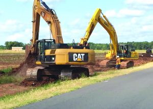 Courtesy Photo | Contractors lay a section of the Bossier Parish sewer project along Cash Point Road.