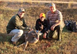 Courtesy of the Bossier Sheriff's Office | Cameron Hollis shot an 8-point buck Saturday.  Pictured with Hollis are Capt. Doyle Dempsey (left) and Chief Deputy Charlie Owens (right).