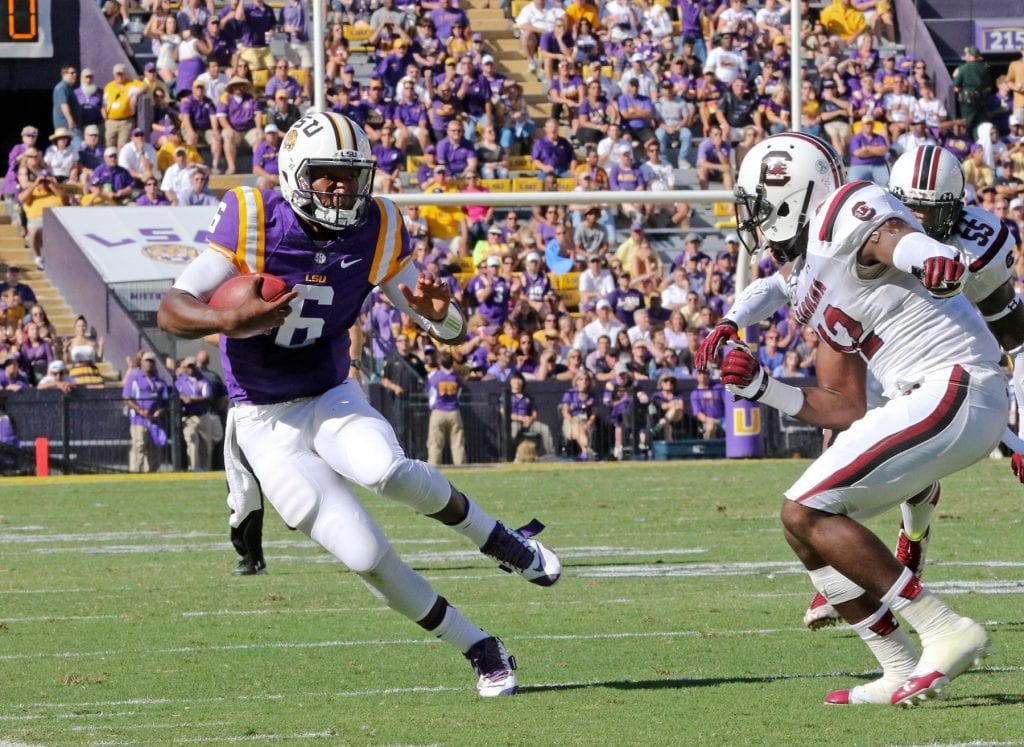 Robert Summerlin/Special to The Press-Tribune LSU quarterback Brandon Harris, a former Parkway star, looks for running room during the Tigers' 45-24 victory over South Carolina on Saturday.