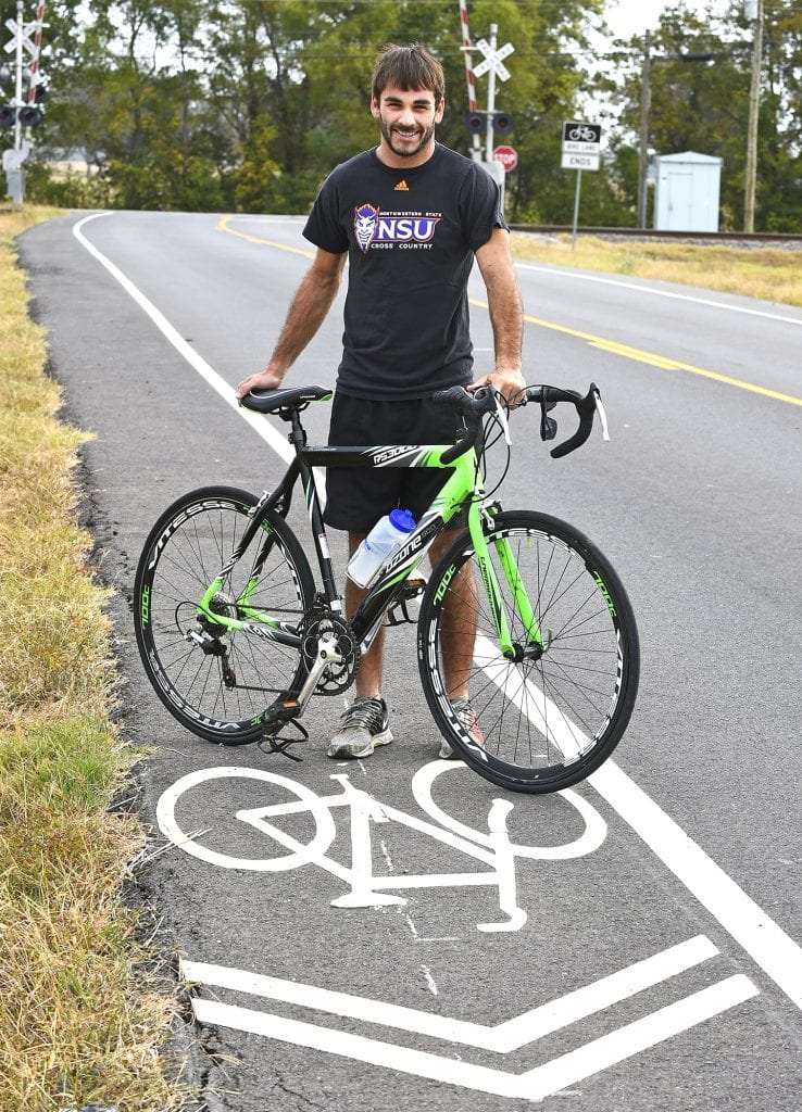 Gary Hardamon/NSU Photographic Services Because of severe foot pain, NSU's Mitch Landry, a former Haughton star, rode a bicycle to stay in shape for his senior cross country season.
