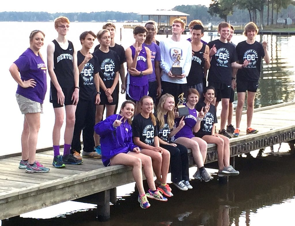 Courtesy Photo/ The Benton Tigers and Lady Tigers pose for a photo after sweeping the District 1-4A cross country championships on Monday at Cypress Lake Park.