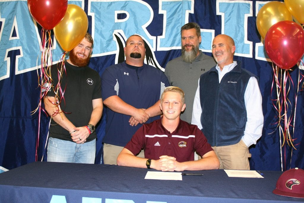 Russell Hedges/Press-Tribune Airline pitcher Kyle Backofen poses with his coaches after signing with ULM during a ceremony Wednesday in the school library.